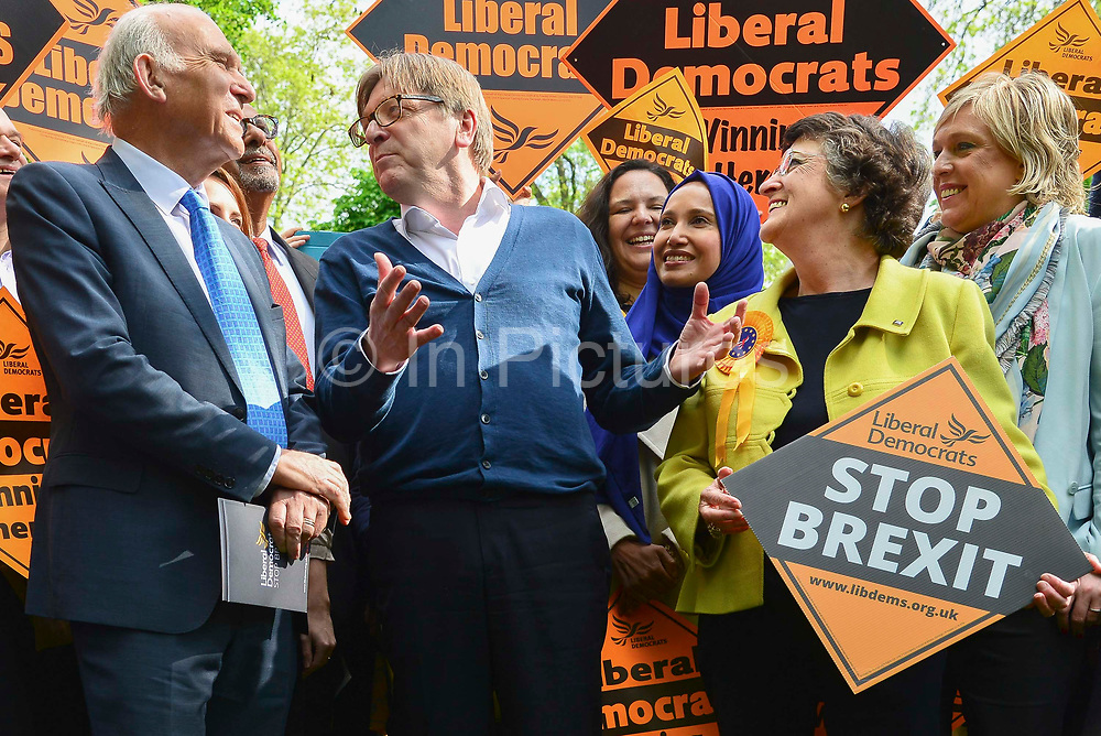 Guy Verhofstadt, Leader of the Alliance of Liberals and Democrats for Europe Party and the European Parliaments chief Brexit negotiator right speaks to Liberal Democrat leader Sir Vince Cable left during a European Parliament elections campaign event with party activists before canvassing for support for their candidates in the forthcoming European elections, on 10th May 2019 in Camden, North London, England, United Kingdom. Sir Vince Cable said the partys message was to stop Brexit.