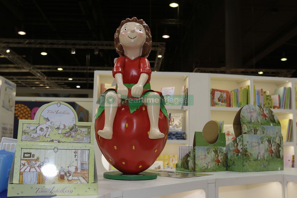 October 14, 2017 - Frankfurt, Hesse, Germany - The statue of a little girl sitting on a strawberry is pictured at the booth of the German children and youth publisher Arena Verlag. The Frankfurt Book Fair 2017 is the world largest book fair with over 7,000 exhibitors and over 250,000 expected visitors. It is open from the 11th to the 15th October with the last two days being open to the general public. (Credit Image: © Michael Debets/Pacific Press via ZUMA Wire)