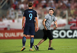 England's Harry Kane with a fan on the pitch during the 2018 FIFA World Cup Qualifying, Group F match at the National Stadium, Ta' Qali. PRESS ASSOCIATION Photo. Picture date: Friday September 1, 2017. See PA story SOCCER Malta. Photo credit should read: Nick Potts/PA Wire. RESTRICTIONS: Use subject to FA restrictions. Editorial use only. Commercial use only with prior written consent of the FA. No editing except cropping.