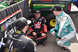March 9, 2019 - Phoenix, Arizona, U.S. - PHOENIX, AZ - MARCH 09:  Ryan Truex (8) MTJ Foundation/Sherry Strong/Catwalk for a Cause Chevrolet,  Cole Custer (00) Haas Automation Ford and Tyler Reddick (2) Hurdl Chevrolet chatting on pit lane prior to start of the race at the NASCAR Xfinity iK9 Service Dog 200 race on March 09, 2019 at ISM Raceway in Phoenix, AZ.  (Photo by Lyle Setter/Icon Sportswire) (Credit Image: © Lyle Setter/Icon SMI via ZUMA Press)