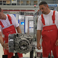 Workers inspect an E-Engine production starts at the Audi factory in Gyor (about 120 km West of Budapest), Hungary on July 24, 2018. ATTILA VOLGYI