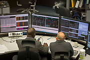 Workers inside the National Grid electricity control room maps and monitors the flow of high voltage electric power around the entire UK network from their head quarters in Berkshire, United Kingdom.