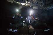 UNIS students Robin de Vries (left) and Nate Stevens explore an ice cave in Tellbreen, Svalbard on a class field trip.