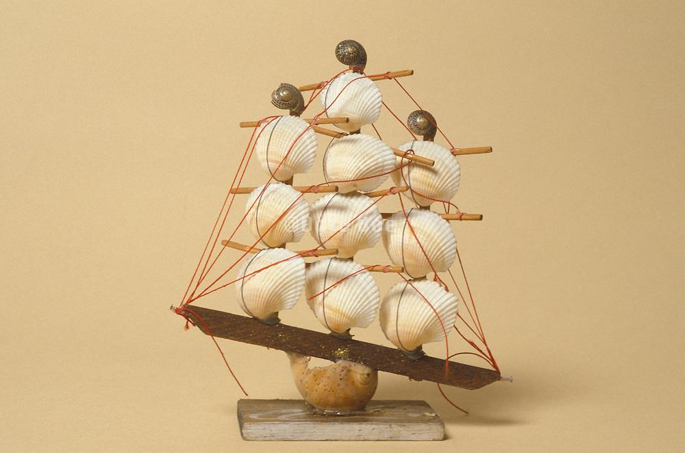 Still life of a model boat made of seashells