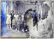 severely eroding glass plate with large extended family group portrait