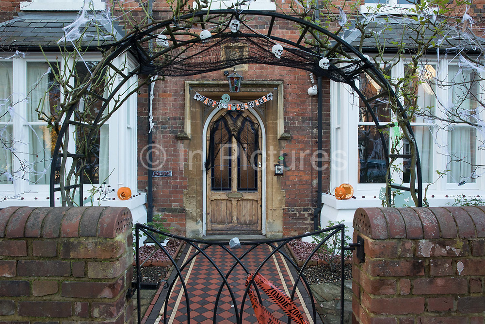 Halloween decorations are arranged outside a house on 31 October 2020 in Windsor, United Kingdom. Halloween celebrations, and in particular the custom of trick-or-treating, will vary across the UK this year due to coronavirus restrictions which differ by Tier alert levels and the Prime Minister's official spokesman has urged people to apply common sense.