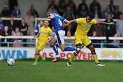 Rochdale FC defender Jim McNulty (4) escapes AFC Wimbledon striker Lyle Taylor (33) tackle during the EFL Sky Bet League 1 match between Rochdale and AFC Wimbledon at Spotland, Rochdale, England on 27 August 2016. Photo by Stuart Butcher.