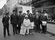 Maureen Potter with The Dublin Fire Brigade..1986..19.07.1986..07.19.1986..19th July 1986..Dublin Fire Brigade aided and abetted by Maureen Potter staged a collection,today,in aid of The Royal Victoria Eye and Ear Hospital,Adelaide Road,Dublin. It is hoped that the proceeds would go towards the purchase of a laser eye scanner. The Eye and Ear Hospital was established in 1897 and has served not only Dublin but the whole country as well...Picture shows Maureen with members of Dublin Fire Brigade and nurses from the Eye and Ear hospital as they start the collection. The fire tender is parked outside Brown Thomas in Grafton Street,Dublin..