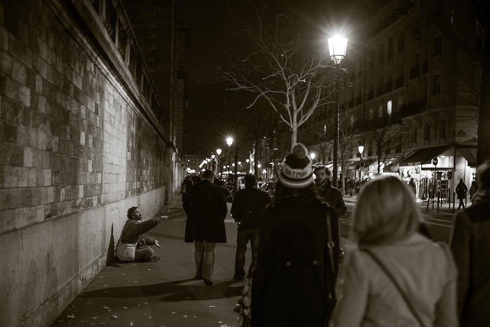 Pan handler, Ile de la Cite. Paris, France. December 1, 2013. Photograph ©2013 Darren Carroll