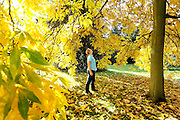 Diana Maynards (39) from Sheffield enjoys the splendour of the Japanese Garden as it changes colour on 9th October 2010. Autumn colour starts to appear at Kew Gardens in West London. © under license to London News Pictures.