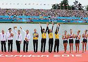 Eton Dorney, Windsor, Great Britain,..2012 London Olympic Regatta, Dorney Lake. Eton Rowing Centre, Berkshire[ Rowing]...LUT W4X Gold Medalist, GER W4X Silver medalist, USA W4X Bronze medalist.   Dorney Lake. 12:47:45  Wednesday  12:47:45   [Mandatory Credit: Peter Spurrier/Intersport Images].