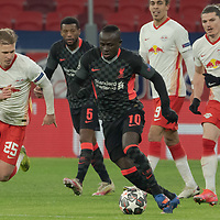 Dani Olmo (L) of RB Leipzig and Sadio Mane (R) of Liverpool FC fight for the ball during the UEFA Champions League Round of 16 First Leg Football match between RB Leipzig and Liverpool FC in Budapest, Hungary on Feb. 16, 2021. ATTILA VOLGYI