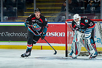 Kelowna, Canada OCTOBER 3: Kyle Pow #21 skates around the net of Roman Basran #30 of the Kelowna Rockets during warm up against the Vancouver Giants on October 3, 2018 at Prospera Place in Kelowna, British Columbia, Canada.  (Photo by Marissa Baecker/Shoot the Breeze)  *** Local Caption ***