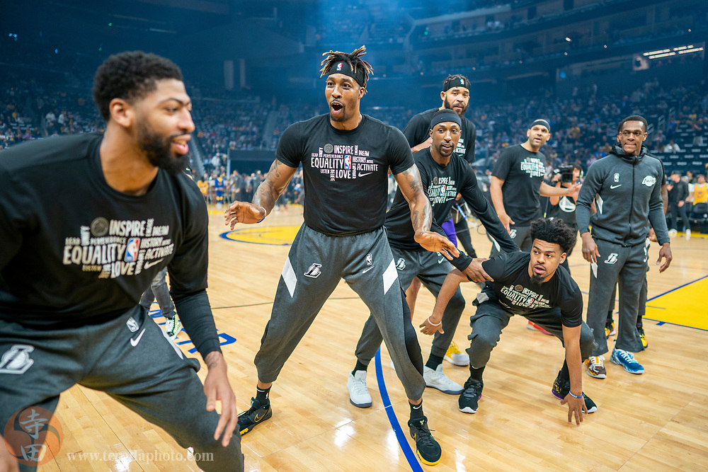 February 27, 2020; San Francisco, California, USA; Los Angeles Lakers center Dwight Howard (39, center) participates in a pre-game routine with teammates before the game against the Golden State Warriors at Chase Center.