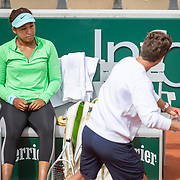 PARIS, FRANCE May 25. Naomi Osaka of Japan practicing on Court Simonne Mathieu with coach Wim Fissette in preparation for the 2021 French Open Tennis Tournament at Roland Garros on May 25th 2021 in Paris, France. (Photo by Tim Clayton/Corbis via Getty Images)
