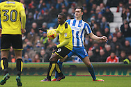 Burton Albion striker Marvin Sordell (9) & Brighton & Hove Albion central defender Lewis Dunk during the EFL Sky Bet Championship match between Brighton and Hove Albion and Burton Albion at the American Express Community Stadium, Brighton and Hove, England on 11 February 2017. Photo by Bennett Dean.