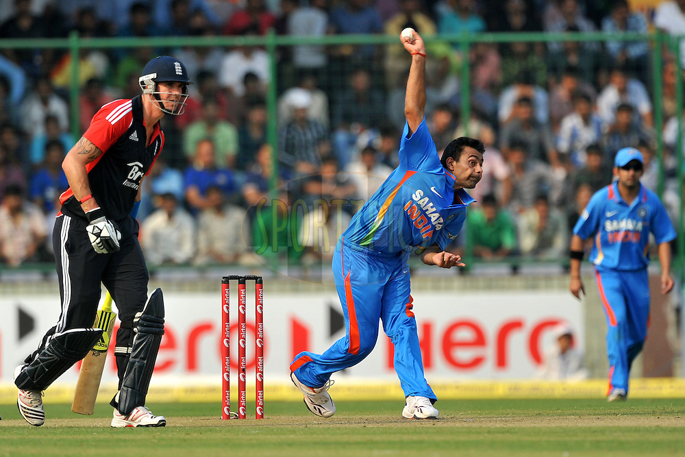 Praveen Kumar of India bowls as Kevin Pietersen of England looks on during the 2nd One Day International ( ODI ) match between India and England held at the The Feroz Shah Kotla Stadium, Delhi on the 17th October 2011..Photo by Pal Pillai/BCCI/SPORTZPICS