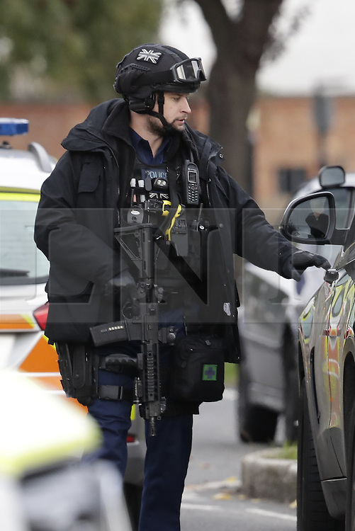 © Licensed to London News Pictures. 22/10/2016. London, UK. Armed police surround a house in Northolt. Police attended an address in Wood End Lane, Northolt at shortly just after midnight on Friday after a report of concerns for the occupant and hazardous items inside the property. Police believe a man is still inside the house. Photo credit: Peter Macdiarmid/LNP