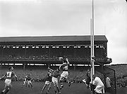 The Kerry goalie dives to save the ball and it goes wide during the All Ireland Senior Gaelic Football Final Kerry v Down in Croke Park on the 22nd September 1960. Down 2-10 Kerry 0-8.