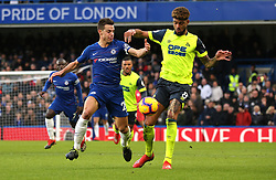 Chelsea's Cesar Azpilicueta (left) and Huddersfield Town's Philip Billing (right) battle for the ball