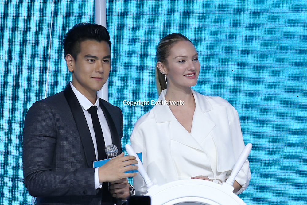 SHANGHAI, CHINA - MARCH 22: (CHINA OUT) Candice Swanepoel, a South African supermodel best known for her work with Victoria\'s Secret, and Chinese actor Eddie Peng attend a commercial activity of Biotherm on March 22, 2016 in Shanghai, China. (Photo by VCG)***_***