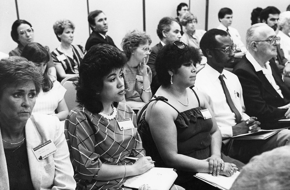 ©1991 People listen to speakers at an aging conference.