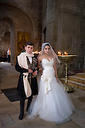 A young bride and groom in the Svetitskhoveli Cathedral, the royal cathedral of Georgia, used for centuries for the coronation and burial of Georgian monarchs. More importantly, it is considered one of the holiest places in Georgia since the Robe of Christ is believed to buried here, having been brought to Georgia in the 1st century by a Jew from Mtskheta named Elias.  The Cathedral lies at the confluence of the Mtkvari and Aragvi rivers, in the town of Mtskheta, which was formerly the capital of the Kingdom of Iberia...10 June 2012