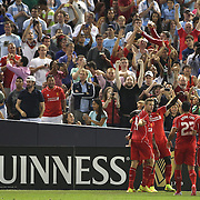 Liverpool players congratulate Raheem Sterling, after scoring his sides second goal during the Manchester City Vs Liverpool FC Guinness International Champions Cup match at Yankee Stadium, The Bronx, New York, USA. 30th July 2014. Photo Tim Clayton