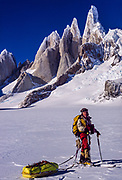 Colin Monteath on ski circuit of Cerro Torre, under west face Cerro Torre on Patagonian icecap - border Chile/Argentina