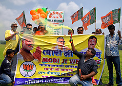 March 29, 2019 - Kolkata, WEST BENGAL, India - Activists of Bharatiya Janata Party (BJP) - the main ruling party of India are seen holding a banner, balloons and flags during the election campaign in kolkata..Supporters are seen campaigning at the Brigade Parade ground for the Prime Minister Mr. Narendra Modi's upcoming visit to Kolkata on April 3 while releasing colourful balloons, message placard during this event for public awareness. (Credit Image: © Avishek Das/SOPA Images via ZUMA Wire)