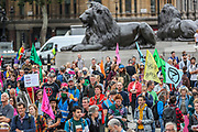 People holding banners, placards and waving flags attend the first day of the environmental activist group Extinction Rebellion (XR) protest in Trafalgar Square, central London on Monday, Aug 23, 2021 - as the movement launched a two-week protest campaign to demand that the government take greater action to address climate change. (VX Photo/ Vudi Xhymshiti)
