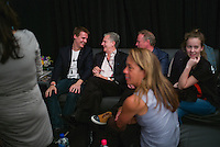 Publisher of The New York Times Arthur Sulzberger, Jr., center, backstage at the Global Citizen's Festival in New York's Central Park. <br /> <br /> <br /> The free, ticketed event is part of the Global Citizen platform, a social media and live-event campaign. Musicians and celebrities join dignitaries and philanthropists to urge world leaders to act towards ending extreme poverty by 2030. Free tickets were earned by fans who logged on to www.globalfestival.com to learn and share content about four main themes: education, women's equality, global health and global partnerships.<br /> <br /> (Photo by Robert Caplin) 2013 Global Citizen's Festival. <br /> <br /> Photo ©Robert Caplin