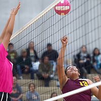 Tohatchi Cougar Latisha Halona (19) bumps the ball over the net guarded by Rehoboth Lynx Mya Begay (9) at Rehoboth Tuesday.