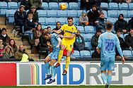 Wimbledon midfielder Anthony Hartigan (8) wins the header  during the EFL Sky Bet League 1 match between Coventry City and AFC Wimbledon at the Ricoh Arena, Coventry, England on 12 January 2019.