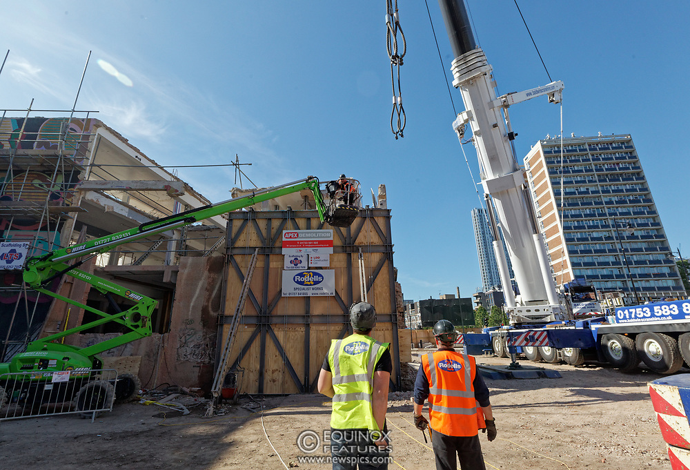 London, United Kingdom - 20 September 2019<br /> EXCLUSIVE SET - Aerial construction specialists and demolition experts use a huge crane to carefully lift intact, a twenty five ton, two-story wall, to preserve a famous Banksy rat image which has been covered up for years. Teams from specialist companies have spent over six weeks cutting around the artwork and fitting custom made eight ton steel supports to enable them to save the historic piece of art. Work has started on the construction of a new twenty seven floor art'otel hotel on the site of the old Foundry building in Shoreditch, east London, and a condition of the planning permission was to preserve the historical Banksy graffiti. A second section of the painting, an image of a TV being thrown through a broken window has already been cut out and moved separately. After the hotel construction is complete the two parts of the Banksy painting will be displayed on the hotel. Our pictures show the stages of work to protect the image, culminating in the lifting of the three story wall by crane. Video footage also available.<br /> (photo by: EQUINOXFEATURES.COM)<br /> Picture Data:<br /> Photographer: Equinox Features<br /> Copyright: ©2019 Equinox Licensing Ltd. +443700 780000<br /> Contact: Equinox Features<br /> Date Taken: 20190920<br /> Time Taken: 12593323<br /> www.newspics.com