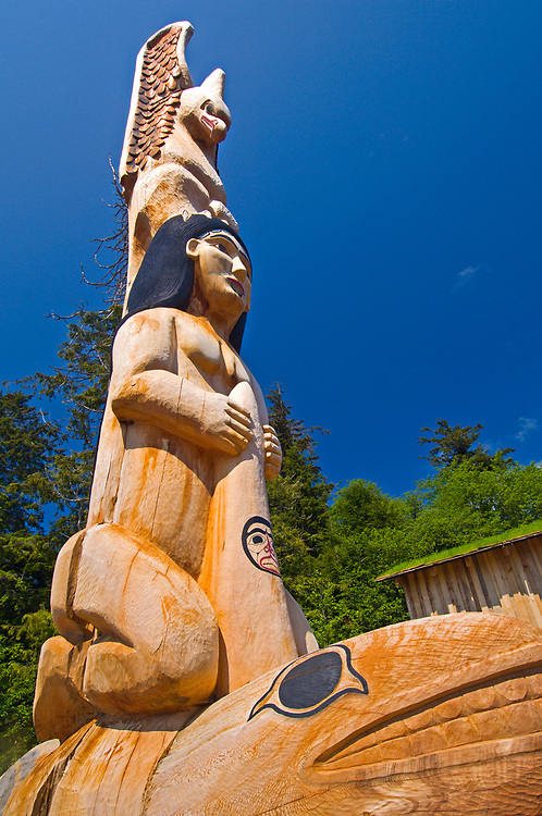 Carved wooden Alaska native traditional totem poles at Potlatch Park, Ketchikan, Alaska