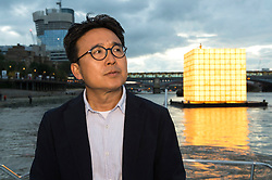 © Licensed to London News Pictures. 31/08/2016.  Artist  IK-JOONG KANG with his  illuminated, large scale floating installation depicting the memories of displaced Koreans, 'FLOATING DREAMS'  calls for the reunification of North and South Korea. It is part of Totally Thames Festival (1-30 September), and is situated in the centre of the River Thames by the Millennium Bridge in London, and illuminated from within.  London, UK. Photo credit: Ray Tang/LNP