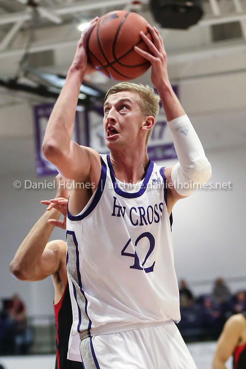 WORCESTER -  Holy Cross' Blake Verbeek goes up for two points during the men's basketball game against Northeastern at Holy Cross in Worcester on Tuesday November 19, 2019. [Photo/Dan Holmes]