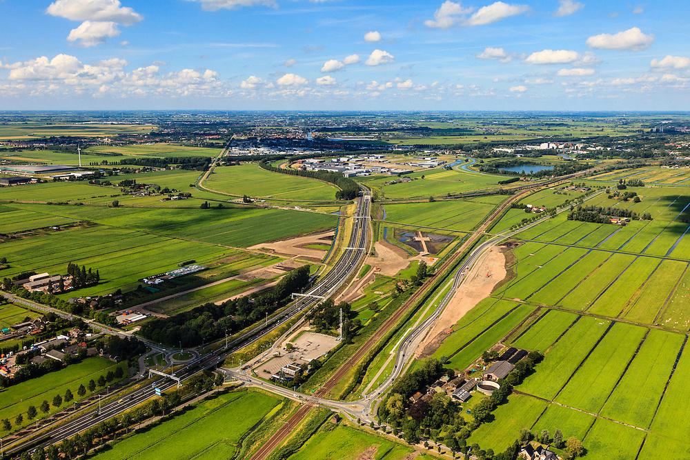 Nederland, Zuid-Holland, Gouda, 15-07-2012; Zuidplaspolder, doorsneden door de A12 en de spoorlijn Gouda - Rotterdam. Lightrail naar Waddinxveen, kassengebied in de polder. Het nu nog overwegend landelijk gebied hoorde oorspronkelijk bij het Groene Hart, maar toekomstplannen voorzien in het verder bebouwen van de polder (vanuit de omliggende steden). .Polder with railroad and highway crossing each other in the Green Heart of the Netherlands near Gouda..luchtfoto (toeslag), aerial photo (additional fee required).foto/photo Siebe Swa