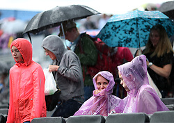 Fans shelter from the rain during day six of the 2017 AEGON Championships at The Queen's Club, London.