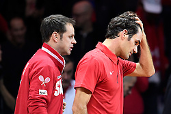 21.11.2014, Stade Pierre Mauroy, Lille, FRA, Davis Cup Finale, Frankreich vs Schweiz, im Bild Roger Federer (SUI) enttaeuscht (L) Captain Severin Luethi (SUI) // during the Davis Cup Final between France and Switzerland at the Stade Pierre Mauroy in Lille, France on 2014/11/21. EXPA Pictures © 2014, PhotoCredit: EXPA/ Freshfocus/ Valeriano Di Domenico<br /> <br /> *****ATTENTION - for AUT, SLO, CRO, SRB, BIH, MAZ only*****