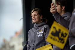 Emma Johansson takes to the stage to receive a gift to mark her achievements in women's racing at the Women's Ronde van Vlaanderen 2017 Team Presentation.