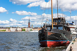 Sailing ship moored at harbour with a church in the background, Riddarfjarden, Stockholm, Sweden