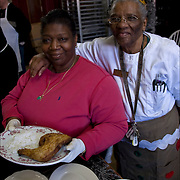 """Sister Jean with one of  Kitchen Volunteers holding plate of food for the homeless. <br /> Volunteers preparing food for Thanksgiving for the homeless a week in advance.<br /> <br /> Jean Webster, a former casino chef 74, found her calling when she saw a man rummaging through a garbage can in search of food. Now she runs a soup kitchen that feeds up to 400 homeless people a day, five days a week in the dinning room of the First Presbyterian Church of Atlantic City.<br /> <br /> No one is turned away. Jean has been called """"Sister Jean"""" or """"Saint Jean"""" or """"the Mother Teresa of Jersey.""""<br /> <br /> She also offers employment counseling and a program designed for transitional housing."""