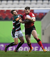 Rugby Union - 2020 / 2021 European Rugby Challenge Cup - Semi-final - Leicester vs Ulster - Welford Road<br /> <br /> Ulster Rugby's Stuart McCloskey evades the tackle of Leicester Tigers' Richard Wigglesworth.<br /> <br /> COLORSPORT/ASHLEY WESTERN