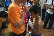Jan 24, 2014 - Chiang Mai, Thailand - <br /> <br /> Nine Year Old Muay Thai Fighter<br /> <br /> Focus and his trainer pray before his fight at the Thapae Muay Thai Stadium in Chiang Mai. PETCHFOGUS SITTHAHARNAEK, 9, aka Focus is the top fighter for his age and weight in Chiang Mai. He has begun fighting older, heavier opponents to continue to improve his skills. Fighters are typically paid 1000 baht (0) per fight.<br /> ©Exclusivepix