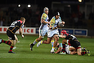 Josh Matavesi  of the Ospreys © is tackled .Guinness Pro12 rugby union, Newport Gwent Dragons v Ospreys at Rodney Parade in Newport, South Wales on Friday 12th Sept 2014<br /> pic by Andrew Orchard, Andrew Orchard sports photography.