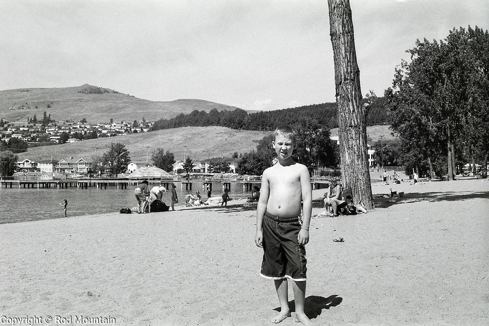 A young boy stands for his photograph in the bright Okanagan sunshine.