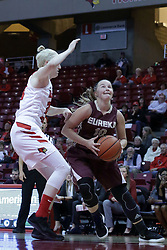 01 November 2017: Ashley Harfst approaches the hoop protected by Hannah Green during a Exhibition College Women's Basketball game between Illinois State University Redbirds the Red Devils of Eureka College at Redbird Arena in Normal Illinois.