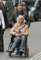 © Licensed to London News Pictures. 11/11/2015. Bristol, UK.  DARREN GALSWORTHY the father of murder victim Rebecca Watts, wheels his wife ANJIE GALSWORTHY, the mother of Nathan Matthews who is accused of Becky Watts' murder, into Bristol Crown court on the day the jury retires to consider their verdict in the Rebecca Watts' murder trial.  Photo credit : Simon Chapman/LNP